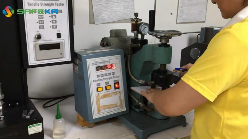 Corrugated board bursting strength testing